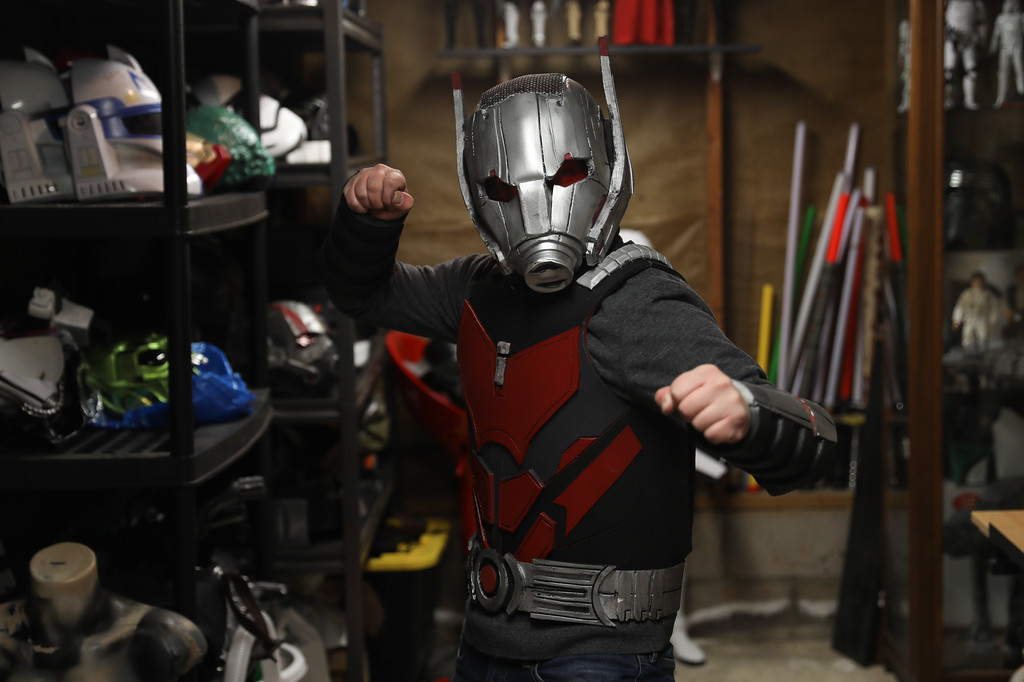 . Ryan Meran stands in his studio wearing an Ant Man costume he created, April 6, 2018, in Chico, California. (Carin Dorghalli -- Enterprise-Record)