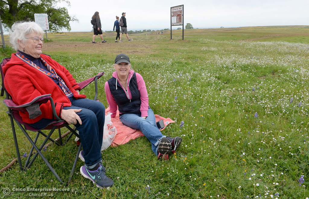 ". Cheryl Pocock of Forest Hill sits with her Mom Maryjane Ashe of Paradise at left, at Table Mountain in Oroville, Calif. Thursday April 5, 2018. ""This is sort of a tradition\""  said Maryjane. (Bill Husa -- Enterprise-Record)"