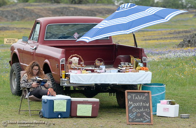"Sherry Otsuka sits beside her truck full of goodies for sale at Table Mountain in Oroville, Calif. Thursday April 5, 2018. Otsuka said she has salsa, Jam, Jerky, Cookies, Rice Crispy Treats, Dog Treats and Free Range Eggs along with some free items she gives out ""like the samples at Costco.""  (Bill Husa -- Enterprise-Record)"