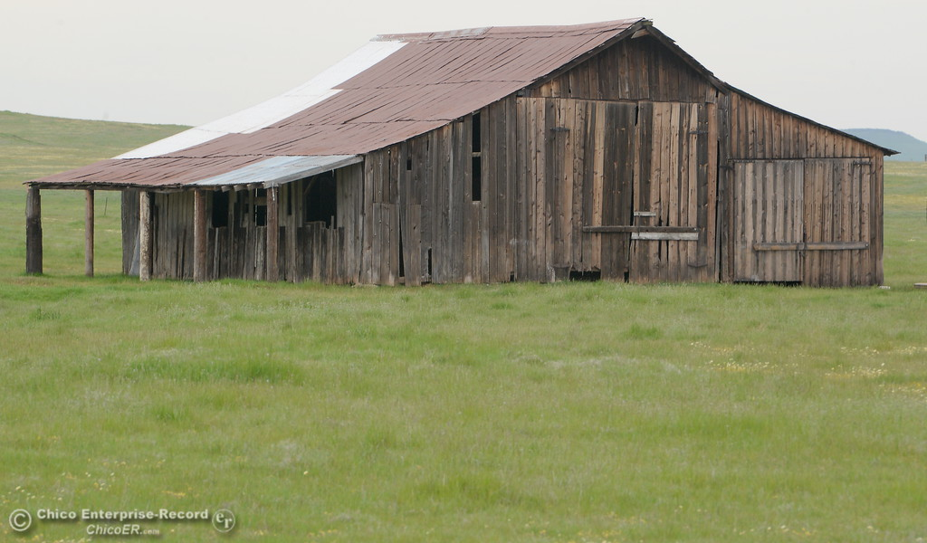 . An old barn sits in the middle of a field seen along Durham Pentz Road near Butte College in Oroville, Calif. Thursday April 5, 2018.  (Bill Husa -- Enterprise-Record)