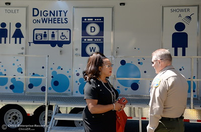Oroville Vice Mayor Janet Goodson talks with Butte County Sheriff Kory Honea in front of a Dignity on Wheels trailer parked at the Southside Community Center where the local nonprofit is presenting plans for a homeless care unit that includes showers, toilet and laundry facility Wednesday May 9, 2018. (Bill Husa -- Enterprise-Record)