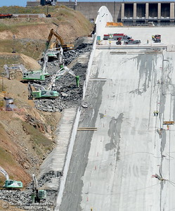 Work is underway on the removal of the roller compacted concrete section of the Oroville Dam Spillway Wednesday May 9, 2018. (Bill Husa -- Enterprise-Record)