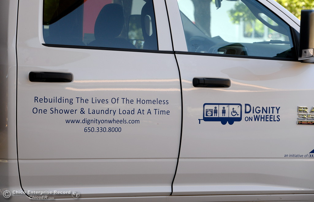 . A sign is seen on the side of a truck at the Southside Community Center where the local nonprofit is presenting plans for a homeless care unit that includes showers, toilet and laundry facility. The program is called Haven of Hope Dignity on Wheels. Wednesday May 9, 2018. (Bill Husa -- Enterprise-Record)