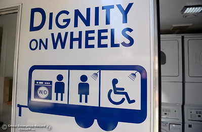 A trailer embossed with Dignity on Wheels is seen while Oroville officials gather at the Southside Community Center where the local nonprofit is presenting plans for a homeless care unit that includes showers, toilet and laundry facility Wednesday May 9, 2018. (Bill Husa -- Enterprise-Record)