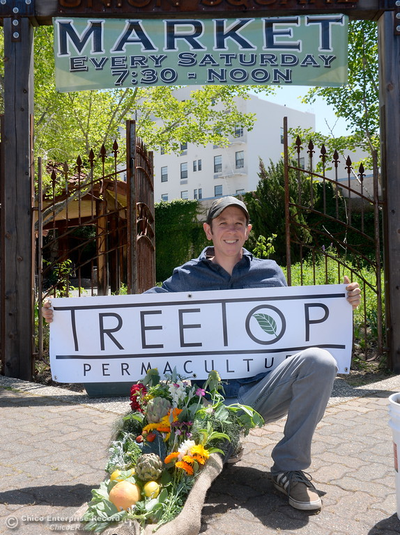 . Permaculture expert Matt Trumm smiles with his Tree Top Permaculture banner at Union Square on Montgomery Street where he now runs a Farmers Market every Saturday from 7:30 - Noon starting May 5th through October 27th in Oroville, Calif. Wednesday May 2. 2018. (Bill Husa -- Enterprise-Record)