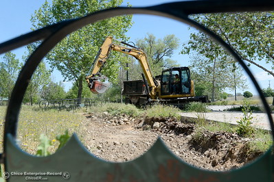 Heavy equipment is used to remove rock and gravel while Riverbend Park remains closed as construction is underway on repairs to the park in Oroville, Calif. Wednesday May 2. 2018. (Bill Husa -- Enterprise-Record)