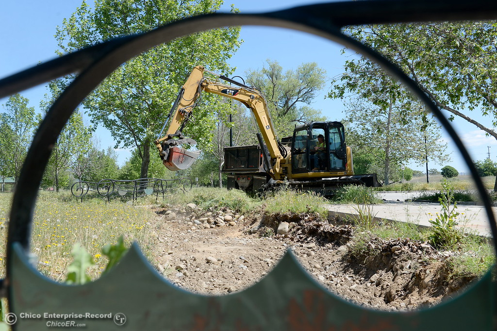 . Heavy equipment is used to remove rock and gravel while Riverbend Park remains closed as construction is underway on repairs to the park in Oroville, Calif. Wednesday May 2. 2018. (Bill Husa -- Enterprise-Record)