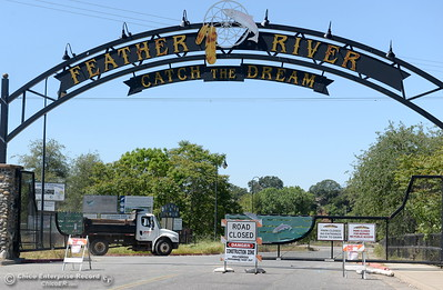 A truck drives past the entrance gate while Riverbend Park remains closed as construction is underway on repairs to the park in Oroville, Calif. Wednesday May 2. 2018. (Bill Husa -- Enterprise-Record)