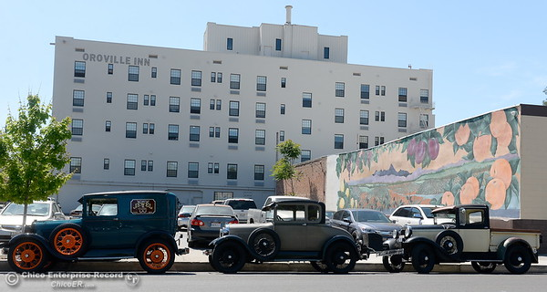 A row of classic cars is seen parked along Montgomery Street near the Oroville Inn in Oroville, Calif. Wednesday May 2. 2018. (Bill Husa -- Enterprise-Record)