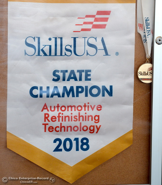 . A Skills USA State Champion banner is seen on display as Las Plumas High School Senior Anna Miller and her Auto Instructor West Upton talk about Miller\'s award winning auto body restoration skills at Las Plumas High School in Oroville, Calif. Wednesday May 2. 2018. (Bill Husa -- Enterprise-Record)