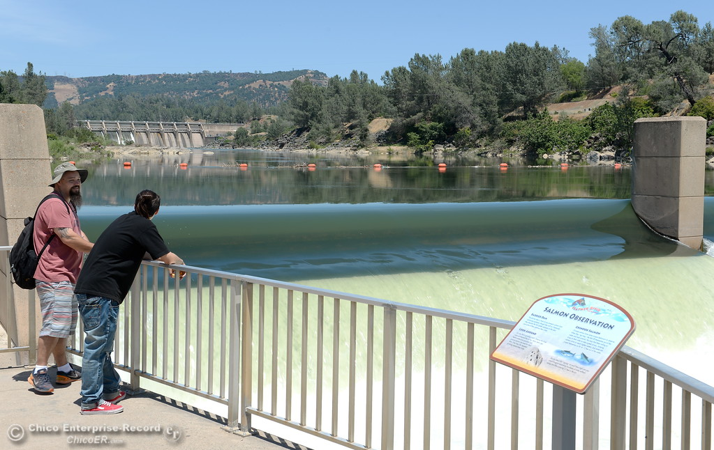 ". Jason Baldwin of Sacramento, left talks with his son Alec Baldwin at the Fish Barrier Dam viewing platform in Oroville, Calif. Monday June 5, 2017. The Baldwin family was on a day trip just checking out the sights around Oroville. Jason said ""This place is beautiful!\"" (Bill Husa -- Enterprise-Record)"