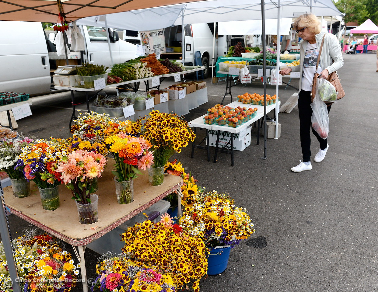 Flowers, fruits and vegetables are some of the items for sale at the Farmers Market in Oroville, Calif. Wed. June 7, 2017. (Bill Husa -- Enterprise-Record)