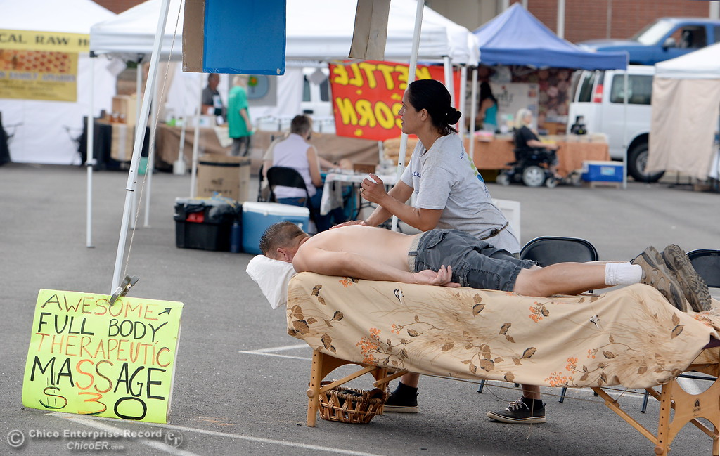 . A man gets a massage during the Farmers Market in Oroville, Calif. Wed. June 7, 2017. (Bill Husa -- Enterprise-Record)