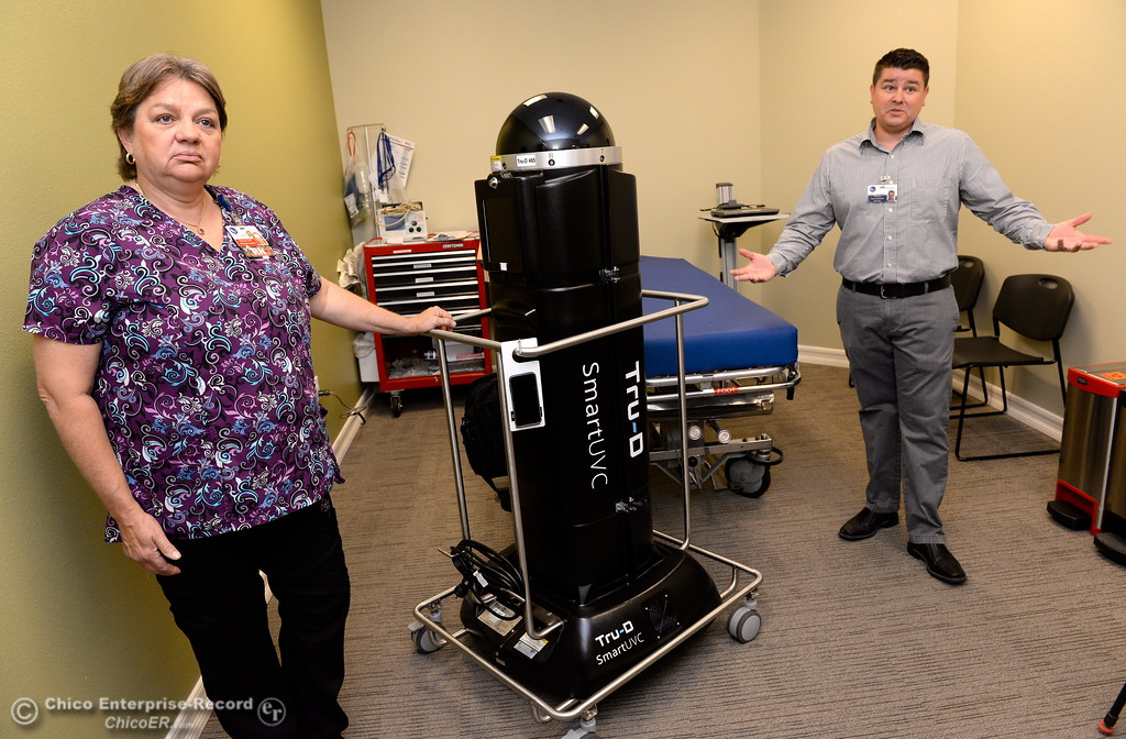 . Kim Basham, Director of infection prevention and Cooper Cunningham, Director of Environmental Services talk about their disinfecting robot Tru-D during a demonstration of the device at Oroville Hospital in Oroville, Calif. Wed. June 7, 2017. (Bill Husa -- Enterprise-Record)