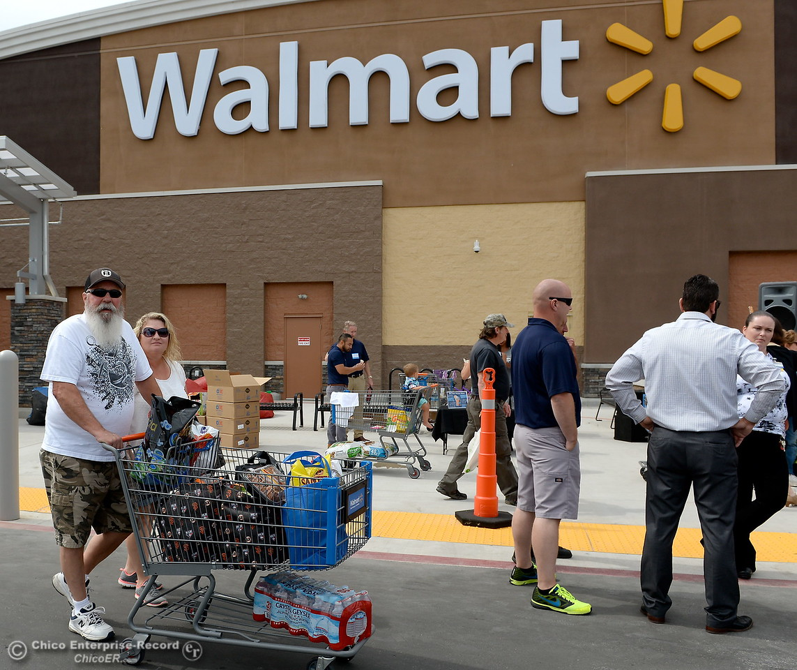 At left Brad and Alison Hammersley of Oroville went on a $230 shopping spree as they and other shoppers enjoy a festive opening at the new Oroville Walmart Supercenter in Oroville, Calif. Wed. June 7, 2017. (Bill Husa -- Enterprise-Record)