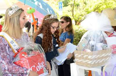Miss Butte county contestants Danielle Todd, left, and Tabitha Machart help out during The Olive Festival on Saturday, June 18, 2016, at the Ehmann Home in Oroville, California. (Dan Reidel -- Enterprise-Record)