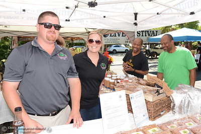 Left to right, Derek and Amy Sohnrey smile as Fred Jenkins and Joel Jenkins peruse the almonds and other goods at the Sohnrey Farms booth during The Olive Festival on Saturday, June 18, 2016, at the Ehmann Home in Oroville, California. (Dan Reidel -- Enterprise-Record)
