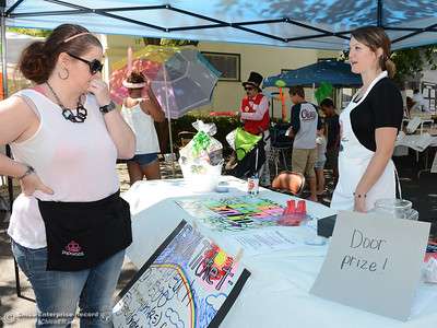 Marnie Sandbloom, left, asks Samantha Becker, right, about the raffle during The Olive Festival on Saturday, June 18, 2016, at the Ehmann Home in Oroville, California. (Dan Reidel -- Enterprise-Record)
