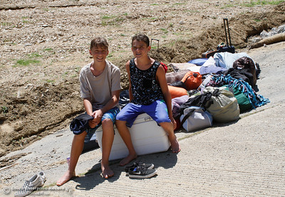 After three day camping on Lake Oroville Cyrus Moezzo and Jaxden Thomson wait with their camping gear as the rest of the family works to get the boat loaded Tuesday June 20, 2017 at Bidwell Canyon Marina  in Oroville, California. (Emily Bertolino -- Mercury Register)
