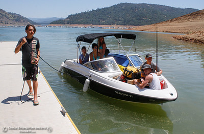 Blaize Thomson helps his family guide the boat to the dock Tuesday June 20, 2017 at Bidwell Canyon Marina in Oroville, California. (Emily Bertolino -- Mercury Register)