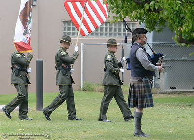 Kurt Baird of Marysville plays the bagpipes as the Color Guard brings in the colors during the fallen peace officers memorial held in honor of Peace Officers Memorial Day at the Butte County Sheriff's office in Oroville, Calif. Wed. May 16, 2018.  (Bill Husa -- Enterprise-Record)