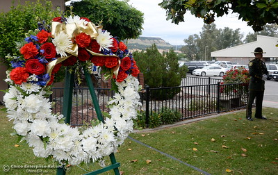 A wreath is seen during the fallen peace officers memorial held in honor of Peace Officers Memorial Day at the Butte County Sheriff's office in Oroville, Calif. Wed. May 16, 2018.  (Bill Husa -- Enterprise-Record)