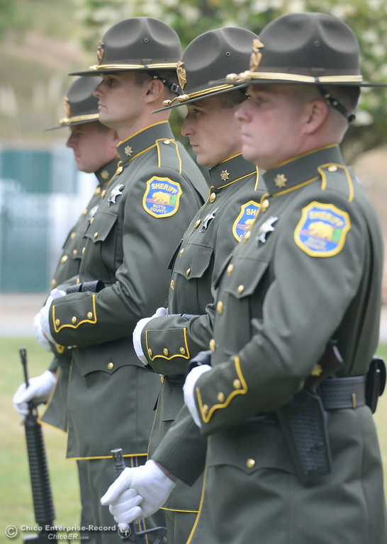. The Color Guard stands by during the fallen peace officers memorial held in honor of Peace Officers Memorial Day at the Butte County Sheriff\'s office in Oroville, Calif. Wed. May 16, 2018.  (Bill Husa -- Enterprise-Record)