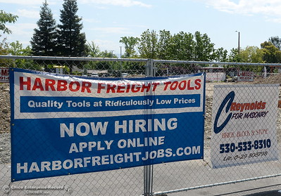 A Now Hiring sign is seen on a fence near the old Walmart shopping center on Oro Dam Blvd. in Oroville, Calif. Tues. May 22, 2018.  (Bill Husa -- Photos)