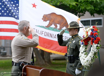 Butte County Sheriff Kory Honea salutes at left during the fallen peace officers memorial held in honor of Peace Officers Memorial Day at the Butte County Sheriff's office in Oroville, Calif. Wed. May 16, 2018.  (Bill Husa -- Enterprise-Record)