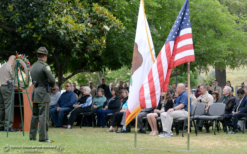 . Law Enforcement members along with family members of fallen officers gather during the fallen peace officers memorial held in honor of Peace Officers Memorial Day at the Butte County Sheriff\'s office in Oroville, Calif. Wed. May 16, 2018.  (Bill Husa -- Enterprise-Record)