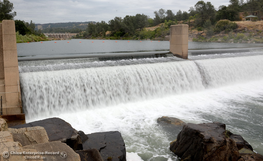 . Water flows over the fish barrier dam in Oroville, Calif. Wed. May 16, 2018.  (Bill Husa -- Enterprise-Record)