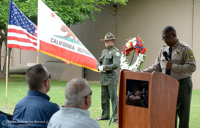 Butte County Sheriff's Office Senior Chaplain Ed Hall speaks during the fallen peace officers memorial held in honor of Peace Officers Memorial Day at the Butte County Sheriff's office in Oroville, Calif. Wed. May 16, 2018.  (Bill Husa -- Enterprise-Record)