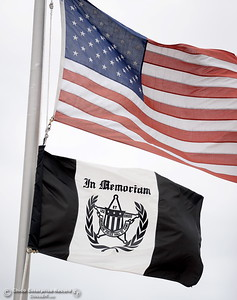 An In Memoriam Flag flys beneath an American Flag flown at half-staff during the fallen peace officers memorial held in honor of Peace Officers Memorial Day at the Butte County Sheriff's office in Oroville, Calif. Wed. May 16, 2018.  (Bill Husa -- Enterprise-Record)