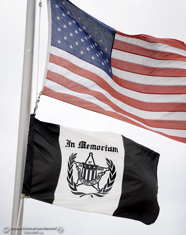 . An In Memoriam Flag flys beneath an American Flag flown at half-staff during the fallen peace officers memorial held in honor of Peace Officers Memorial Day at the Butte County Sheriff\'s office in Oroville, Calif. Wed. May 16, 2018.  (Bill Husa -- Enterprise-Record)