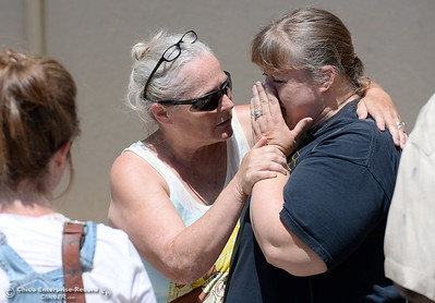 """At left, Jeanean Boatwright-Krejci tries to console Carolyn Opalenik as they and other people impacted by the Wall Fire stand in line at the Municipal Auditorium Assistance Center Tuesday July 11, 2017. Opalenik said """"It's all gone. We have pictures and it's all gone."""" (Bill Husa -- Enterprise-Record)"""