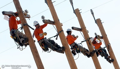 Climbers compete during the Northwest Lineman College Rodeo held at the NLC training center in Oroville, Calif. Friday July 14, 2017. (Bill Husa -- Enterprise-Record)