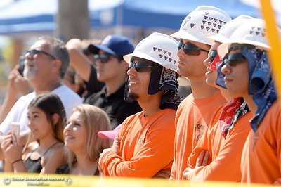 Climbers watch beside family and friends during the Northwest Lineman College Rodeo held at the NLC training center in Oroville, Calif. Friday July 14, 2017. (Bill Husa -- Enterprise-Record)