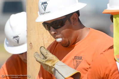 Richard Rubio coughs up an egg during the Northwest Lineman College Rodeo held at the NLC training center in Oroville, Calif. Friday July 14, 2017. (Bill Husa -- Enterprise-Record)