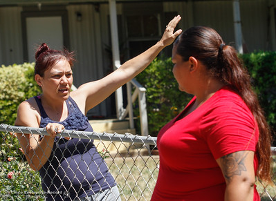 Sandra Munoz describes watching the Wall Fire flames come up over the mountain just behind her house as her sister Maira Munoz looks on Thursday July 13, 2017 in Oroville, California.  (Emily Bertolino -- Enterprise-Record)