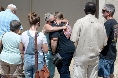 People impacted by the Wall Fire stand in line at the Municipal Auditorium Assistance Center Tuesday July 11, 2017. (Bill Husa -- Enterprise-Record)