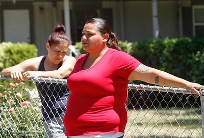 Maira Munoz talks about here experience evacuating  during the while fire as her sister Sandra Munoz listens Thursday July 13, 2017 in Oroville, California.  (Emily Bertolino -- Enterprise-Record)
