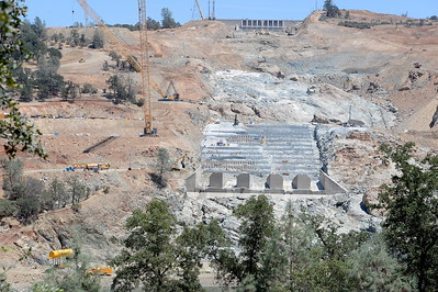 Cranes and men can be seen around the Spillway as construction continues at the Lake Oroville Dam Spillway Monday 7-17-2017. (Bill Husa -- Enterprise-Record)