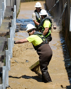 Joe Amoroso looks over his shoulder as Department of Fish & Wildlife Technicians shut down the fish ladder and crowd out the remaining fish at the Feather River Fish Hatchery in Oroville, Calif. Mon. July 17, 2017. (Bill Husa -- Enterprise-Record)
