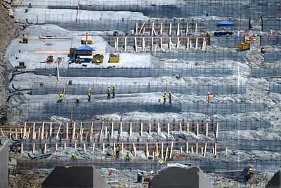 Cranes and workers can be seen around the Spillway as construction continues at the Lake Oroville Dam Spillway Monday 7-17-2017. (Bill Husa -- Enterprise-Record)