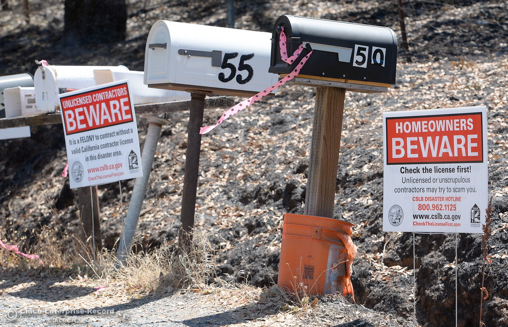 . Signs give warnings to contractors and homeowners as they begin to rebuild in the Wall Fire area in Oroville, Calif. Wed. July 26, 2017. (Bill Husa -- Enterprise-Record)