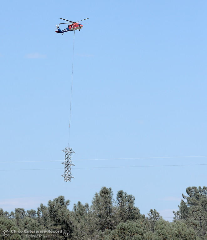 . A large helicopter carries a section of a new tower seen from the Fish Barrier Dam in Oroville, Calif. Mon. July 24, 2017.  (Bill Husa -- Enterprise-Record)