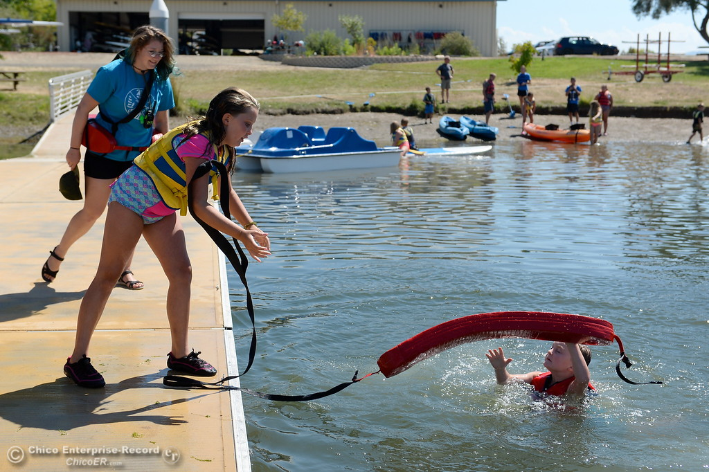 . Top left, Instructor Ashley Freitas teaches summer program participants at the Forebay Aquatic Center how to perform dock rescues at the Forebay in Oroville, Calif. Wed. July 26, 2017. (Bill Husa -- Enterprise-Record)