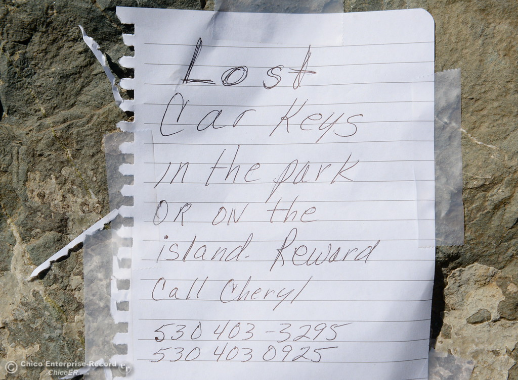 . A sign posted by someone who lost her car keys is seen taped to a rock near Bedrock Park in Oroville, Calif. Wed. July 26, 2017. (Bill Husa -- Enterprise-Record)
