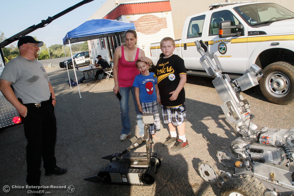 . Brothers Shane, 7, and Sam Knipp, 10, look at the  Butte County Inter-Agency Bomb Squad\'s robots during the annual National Night Out Tuesday August 1, 2017 at the Municipal Auditorium in Oroville, California. (Emily Bertolino -- Enterprise- Record)