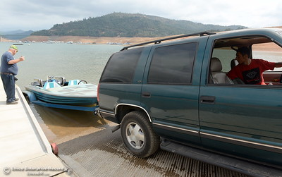 Wayne Jamison watches as his son Pasha Prokopenko backs in his restored speedboat for it's maiden voyage on some new parts at Lake Oroville in Oroville, Calif. Thursday Sept. 14, 2017. (Bill Husa -- Enterprise-Record)